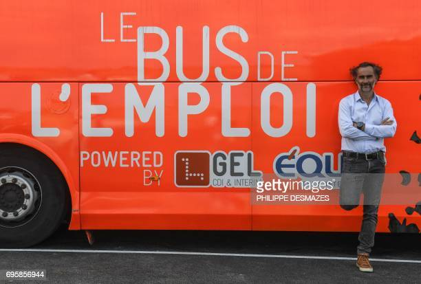 Gel groupe founder and CEO Guilhem de Lajarte poses in front of 'the job bus' on June 12 2017 at the headquarters in SaintAndrédeCorcy near Lyon...