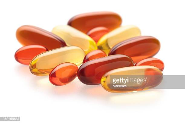 Gel vitamin supplements on white