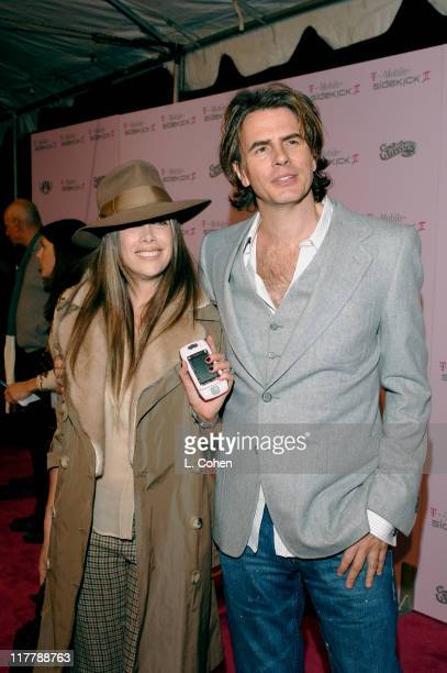 Gela Nash of Juicy Couture and John Taylor during TMobile Sidekick II Custom Series Launch Party Red Carpet at TMobile Sidekick II City in Los...