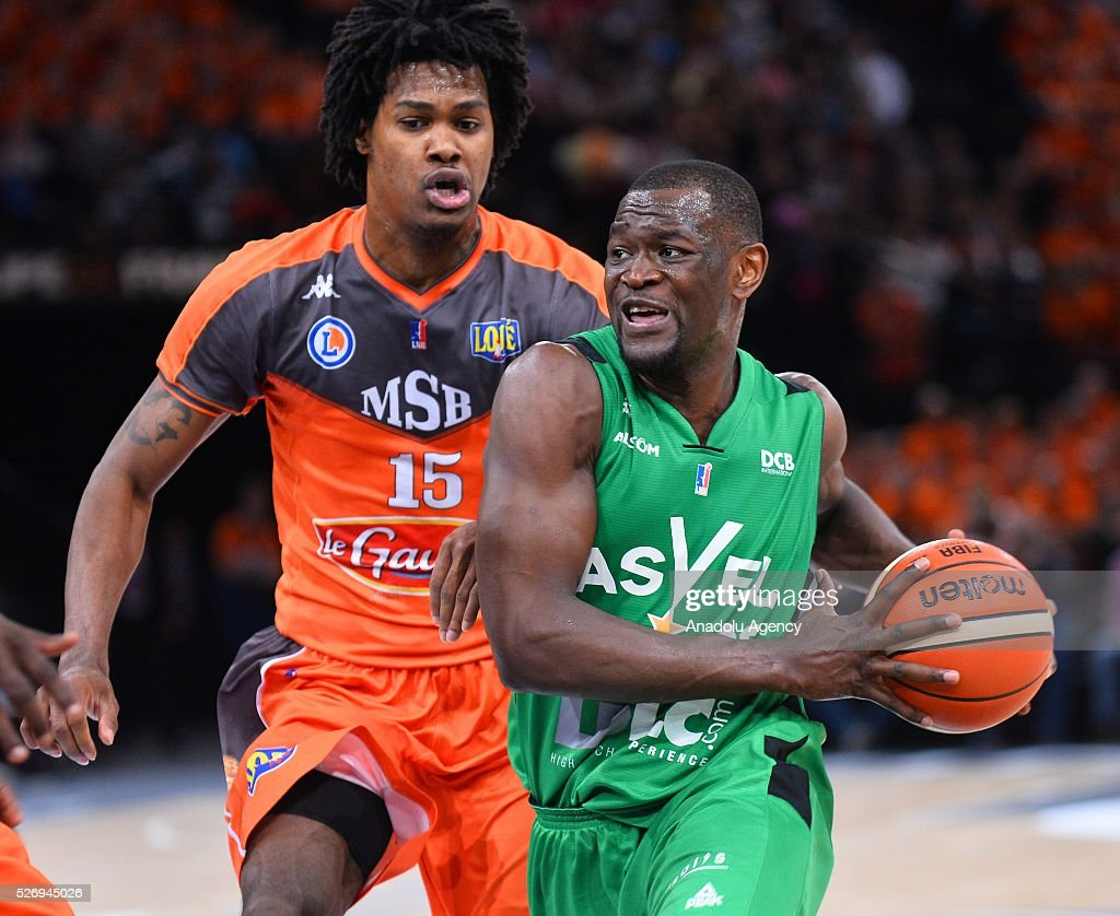 Gelabale of Le Mans (L) vies with Kahudi of ASVEL (R) during the Basketball men's National Cup Final match between ASVEL and Le Mans at Hotel Accor Arena Bercy on May 1, 2016 in Paris, France.