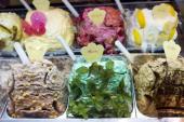 Gelato ice cream shop selling mint hazlenut coffee lemon strawberry flavours in Siena Italy#13#10