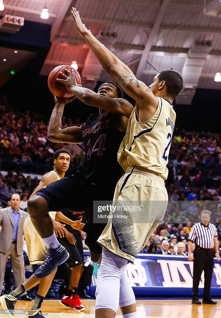Ge'Lawn Guyn #14 of the Cincinnati Bearcats shoots the ball against Zach Auguste #2 of the Notre Dame Fighting Irish at Purcell Pavilion on February 24, 2013 in South Bend, Indiana.