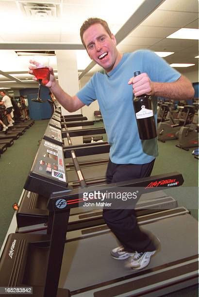 Gelbart on a treadmill with a very expensive red wine