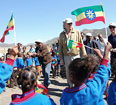 MAASHO **Geldof in Ethiopia to mark 25 years since famine** Dozens of flagwaving children and women held flags and a banner that reads 'No more...