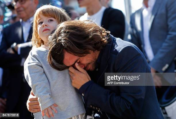 Gelete Nieto and his daughter Mia attend a tribute for his father motorcycling legend Angel Nieto at the Santiago Bernabeu stadium in Madrid on...