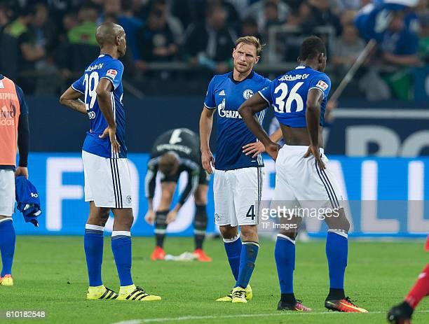Gelsenkirchen Germany 1Bundesliga 4 Spieltag FC Schalke 04 1FC Koeln 13 Naldo Benedikt Hoewedes und Breel Embolo nach der 13 niederlage