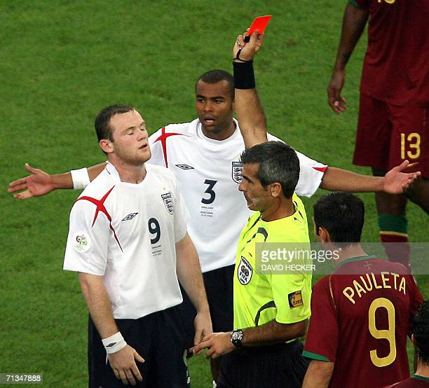 Argentinian referee Horacio Elizendo gives a red card to English forward Wayne Rooney as English defender Ashley Cole and Portuguese forward Pauleta...
