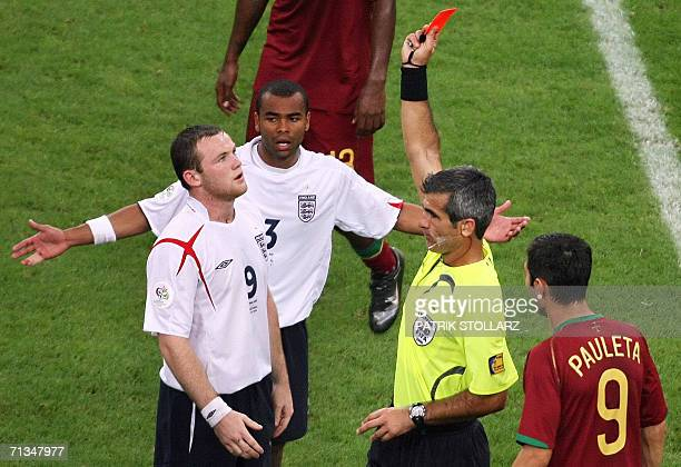 Argentinian referee Horacio Elizondo shows the red card to English forward Wayne Rooney during the World Cup 2006 quarter final football game England...