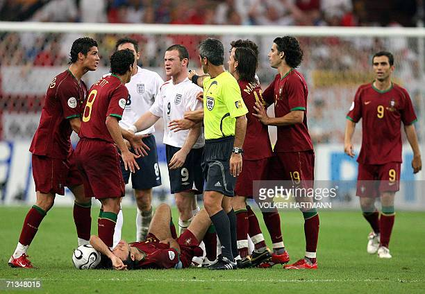 English forward Wayne Rooney argues with Portuguese midfielder Petit and Portuguese forward Cristiano Ronaldo after being given a red card by...