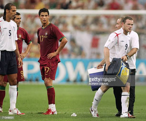 English forward Wayne Rooney leaves the pitch after his red card next to Portuguese forward Cristiano Ronaldo during the World Cup 2006 quarter final...