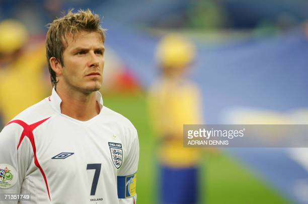 English midfielder and captain David Beckham listens to his national anthem prior to the World Cup 2006 quarter final football game England vs...