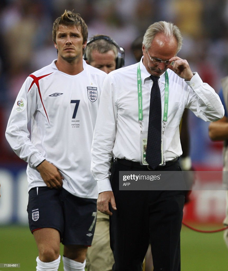English midfielder David Beckham (L) and Swedish head coach of the English team Sven-Goran Eriksson look dejected at the end of the World Cup 2006 quarter final football game England vs. Portugal, 01 July 2006 at Gelsenkirchen stadium. Portugal won 3-1 on penalties.