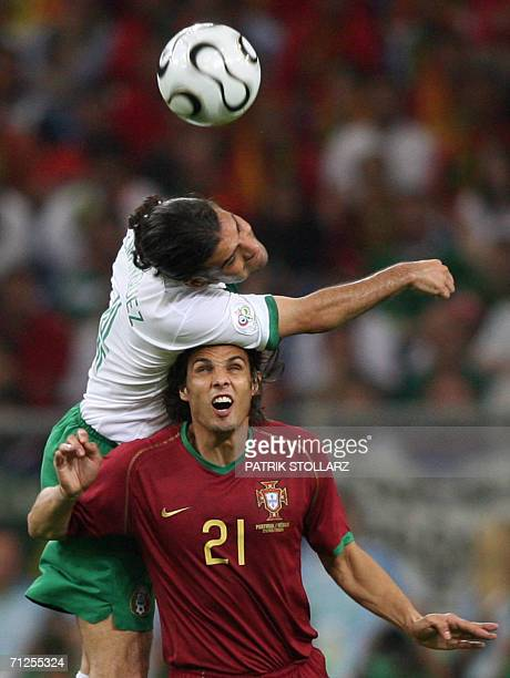 Mexican defender Rafael Marquez heads the ball despite Portuguese forward Nuno Gomes during the World Cup 2006 group D football game Portugal vs...