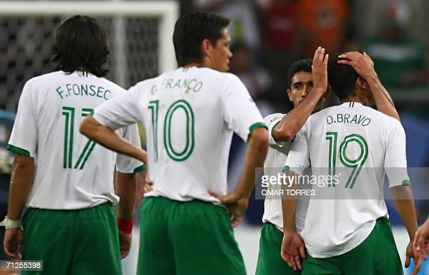 Mexican forward Omar Bravo forward Guillermo Franco and forward Francisco Fonseca looks dejected at the endof the World Cup 2006 group D football...