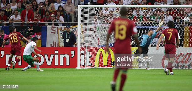 Mexican goalkeeper Oswaldo Sanchez misses the goal of Portuguese midfielder Maniche during the World Cup 2006 group D football game Portugal vs...