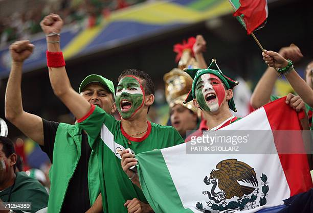 Mexican supporters wave national flag prior to the World Cup 2006 group D football game Portugal vs Mexico 21 June 2006 at Gelsenkirchen stadium AFP...