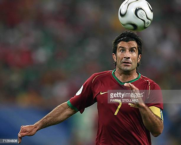 Portuguese forward Luis Figo eyes the ball during the World Cup 2006 group D football game Portugal vs Mexico 21 June 2006 at Gelsenkirchen stadium...