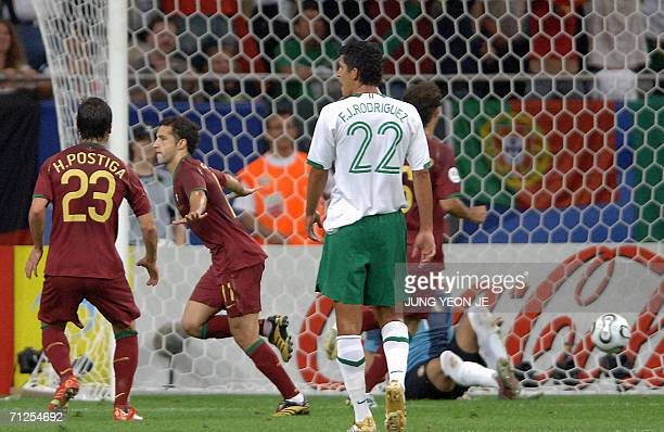 Portuguese forward Simao Sabrosa celebrates aftr scoring a penalty in front of Mexican defender Francisco Rodriguez during the World Cup 2006 group D...