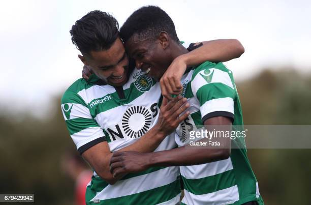 Gelson Dala of Sporting CP B celebrates with teammate Pedro Delgado of Sporting CP B after scoring a goal during the Segunda Liga match between...