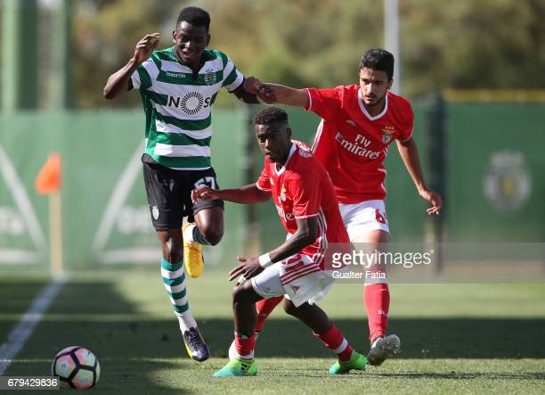 Gelson Dala of Sporting CP B with Heriberto Tavares of SL Benfica B and Joao Escoval of SL Benfica B in action during the Segunda Liga match between...