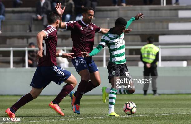 Gelson Dala of Sporting CP B with Roberto Cunha of CD Cova da Piedade in action during the Segunda Liga match between CD Cova da Piedade and Sporting...