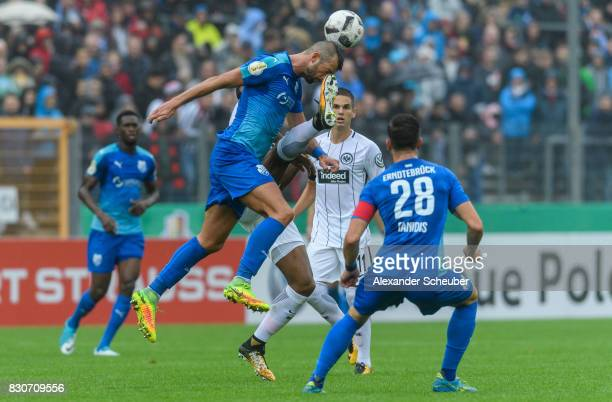 Gelson Fernandes of Eintracht Frankfurt challenges Mehmedalija Covic of TuS Erndtebrueck during the DFB Cup match between TuS Erndtebrueck and...