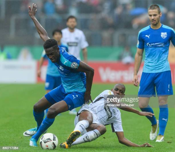 Gelson Fernandes of Eintracht Frankfurt challenges Mory Konate of TuS Erndtebrueck during the DFB Cup match between TuS Erndtebrueck and Eintracht...