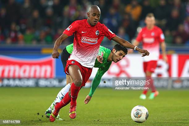 Gelson Fernandes of Freiburg battles for the ball with Lars Stindl of Hannover during the Bundesliga match between SC Freiburg and Hannover 96 at...