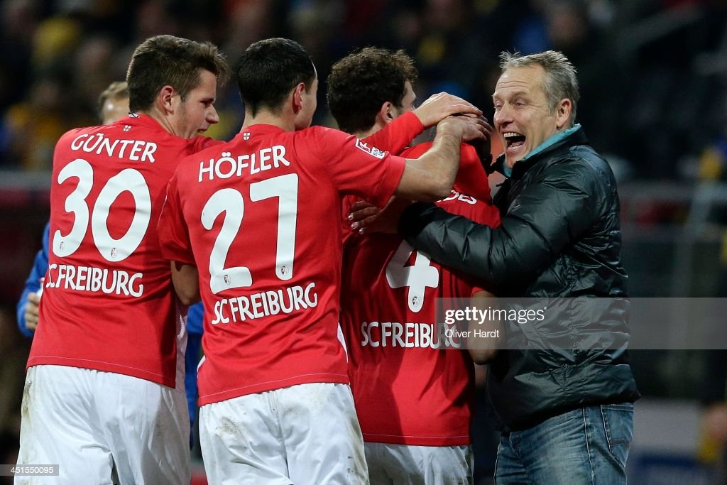 <a gi-track='captionPersonalityLinkClicked' href=/galleries/search?phrase=Gelson+Fernandes&family=editorial&specificpeople=2971817 ng-click='$event.stopPropagation()'>Gelson Fernandes</a> (C) of Freiburg celebrates after scoring their first goal with Head coach <a gi-track='captionPersonalityLinkClicked' href=/galleries/search?phrase=Christian+Streich&family=editorial&specificpeople=4411796 ng-click='$event.stopPropagation()'>Christian Streich</a> (R) during the Bundesliga match between Eintracht Braunschweig and SC Freiburg at Eintracht Stadion on November 23, 2013 in Braunschweig, Germany.