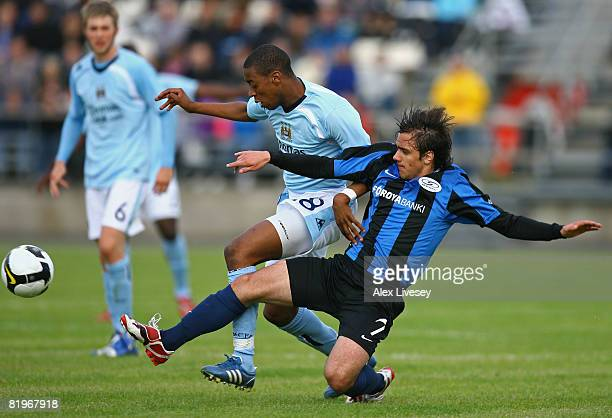 Gelson Fernandes of Manchester City is tackled by Levi Hanssen of EB/Streymur during the UEFA Cup 1st Round 1st Leg Qualifying match between...