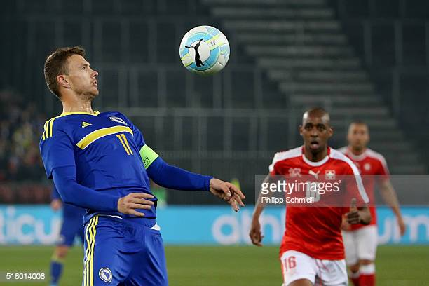 Gelson Fernandes of Switzerland looks on as Edin Dzeko of BosniaHerzegovina controls the ball during the international friendly match between...