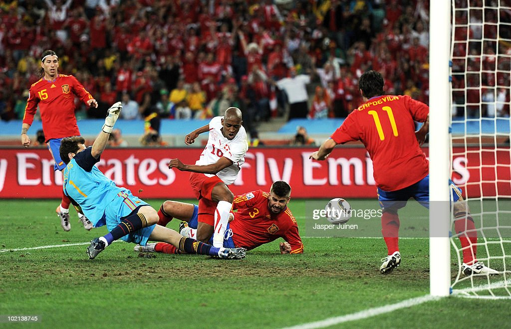 <a gi-track='captionPersonalityLinkClicked' href=/galleries/search?phrase=Gelson+Fernandes&family=editorial&specificpeople=2971817 ng-click='$event.stopPropagation()'>Gelson Fernandes</a> of Switzerland scores the first goal during the 2010 FIFA World Cup South Africa Group H match between Spain and Switzerland at Durban Stadium on June 16, 2010 in Durban, South Africa.