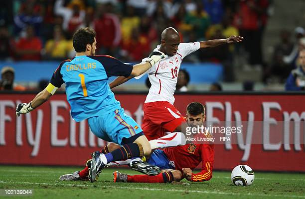 Gelson Fernandes of Switzerland scores the first goal while goalkeeper Iker Casillas and Gerard Pique of Spain can't save during the 2010 FIFA World...