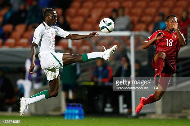Gelson Martins of Portugal and Alhassane Sylla of Senegal stretch for the ball during the FIFA U20 World Cup New Zealand 2015 Group C match between...