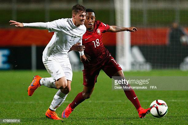 Gelson Martins of Portugal and Cory Brown of New Zealand battle for the ball during the FIFA U20 World Cup New Zealand 2015 Round of 16 match between...