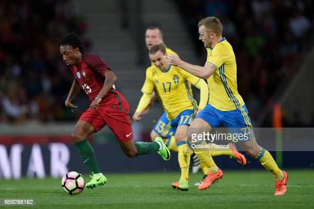Gelson Martins of Portugal competes for the ball with Sebastian Larsson of Sweden during the International friendly match between Portugal and Sweden...