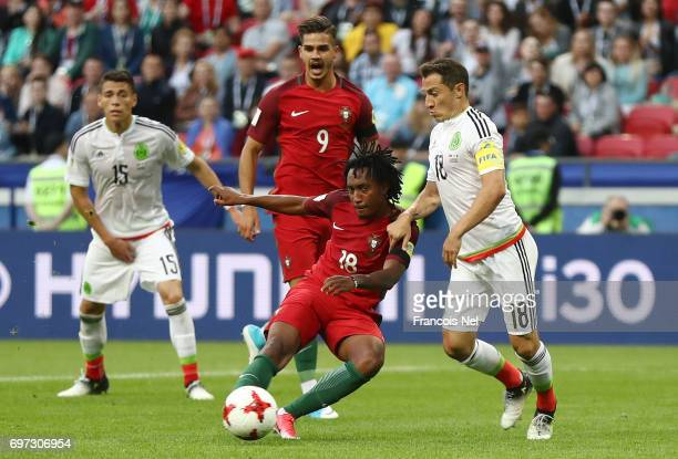 Gelson Martins of Portugal shoots as Andres Guardado of Mexico attempts to block during the FIFA Confederations Cup Russia 2017 Group A match between...