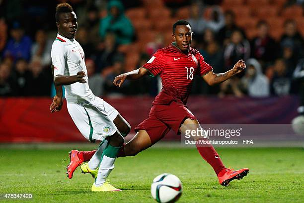 Gelson Martins of Portugal shoots on goal as Elimane Cisse of Senegal looks on during the FIFA U20 World Cup New Zealand 2015 Group C match between...