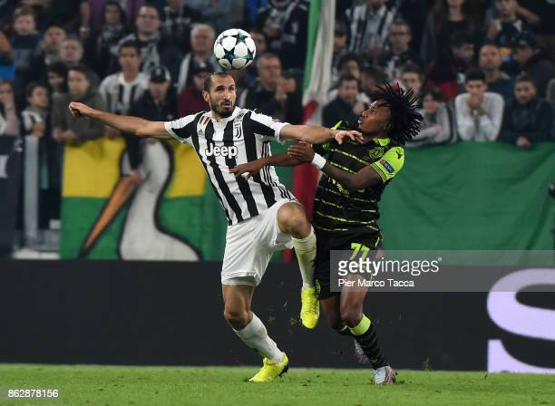 Gelson Martins of Sporting CP competes for the ball with Giorgio Chiellini of Juventus during the UEFA Champions League group D match between...