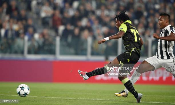 Gelson Martins of Sporting CP vies for the ball against Alex Sandro of Juventus during the UEFA Champions League group D football match between FC...