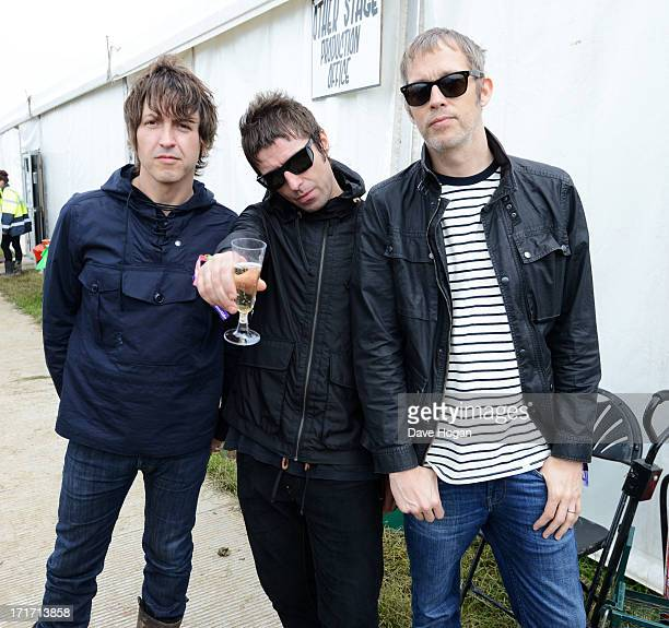 Gem Archer Liam Gallagher and Andy Bell of Beady Eye pose backstage at day 2 of the 2013 Glastonbury Festival at Worthy Farm on June 28 2013 in...