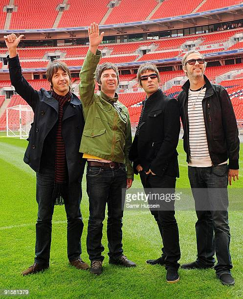 Gem Archer Noel Gallagher Liam Gallagher and Andy Bell of Oasis pose at Wembley Stadium on October 16 2008 in London England