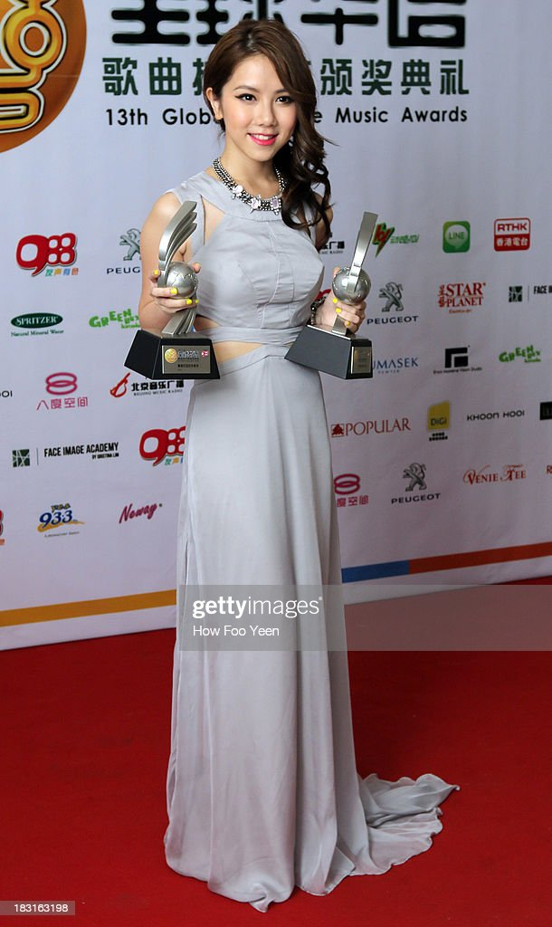Gem of Hong Kong poses with her Most Popular Composing Artiste Award and Top 20 Song Award during the 13th Global Chinese Music Awards at Putra Stadium on October 5, 2013 in Kuala Lumpur, Malaysia.