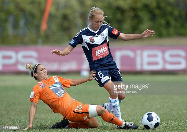 Gema Simon of Melbourne is tackled by KatrinaLee Gorry of Brisbane during the round six WLeague match between Brisbane and Melbourne at Goodwin Park...