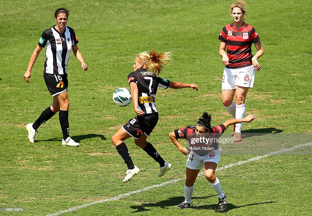 Gema Simon of the Jets and Alesha Clifford of the Wandereers contest possession during the round six W-League match between the Western Sydney Wanderers and the Newcastle Jets at Campbelltown Sports Stadium on November 25, 2012 in Sydney, Australia.