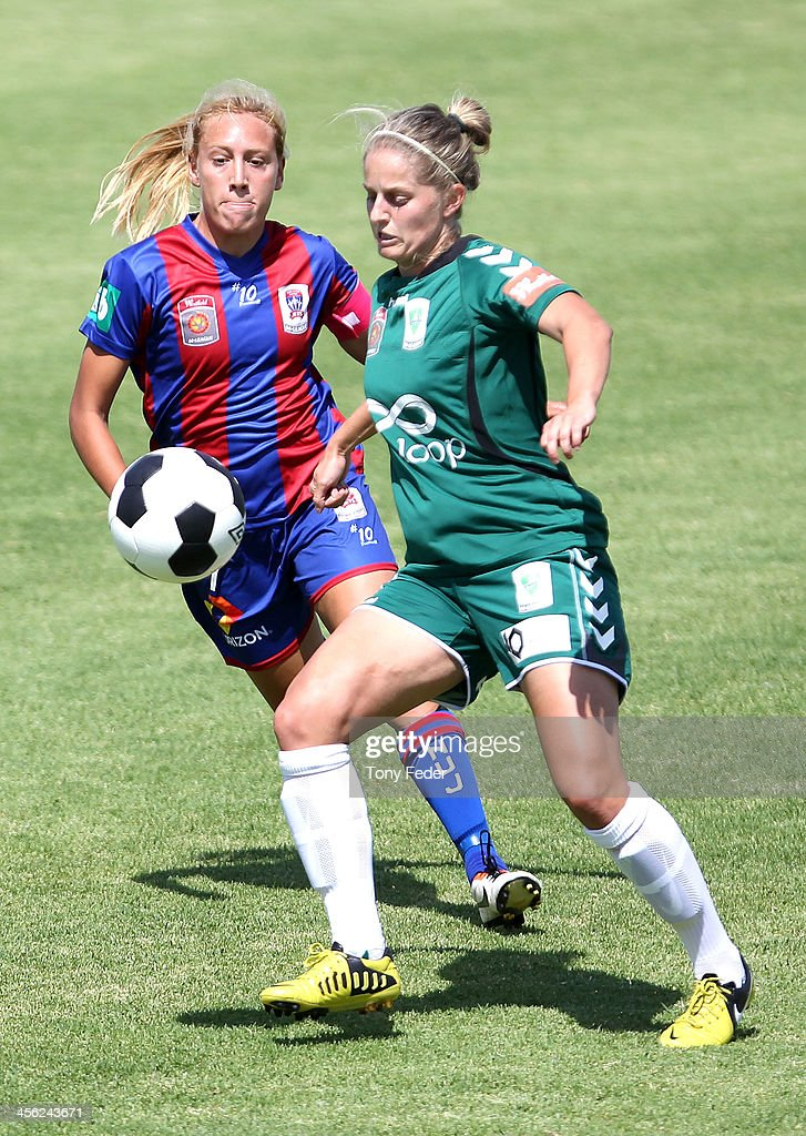 Gema Simon of the Jets contests the ball against Ellie Brush of Canberra United during the round five W-League match between the Newcastle Jets and Canberra United at Wanderers Oval on December 14, 2013 in Newcastle, Australia.