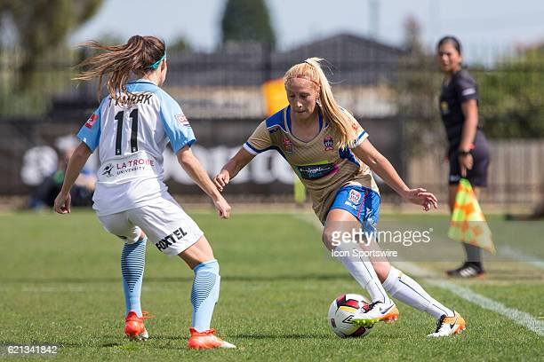 Gema Simon of the Newcastle Jets Women controls the ball in front of Erika Tymrak of Melbourne City Women during the 1st round of the Westfield...
