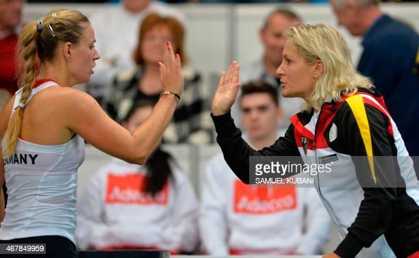 Gemany's Angelique Kerber reacts with team captain Barbara Rittner during the Fed Cup between Slovakia and Germany on February 8 2014 in Bratislava...