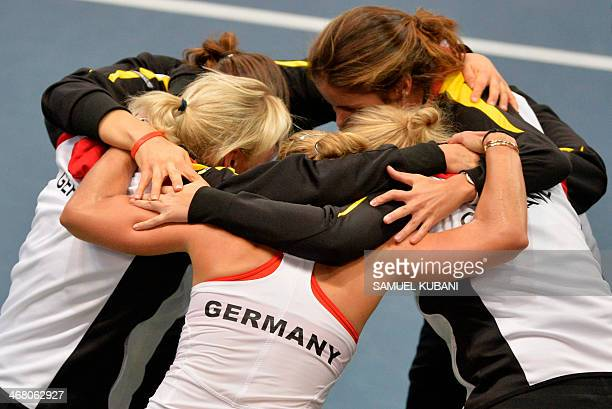 Gemany's team celebrates after Angelique Kerber won against Slovakia's Dominika Cibulkova during the Fed Cup match between Slovakia and Germany on...