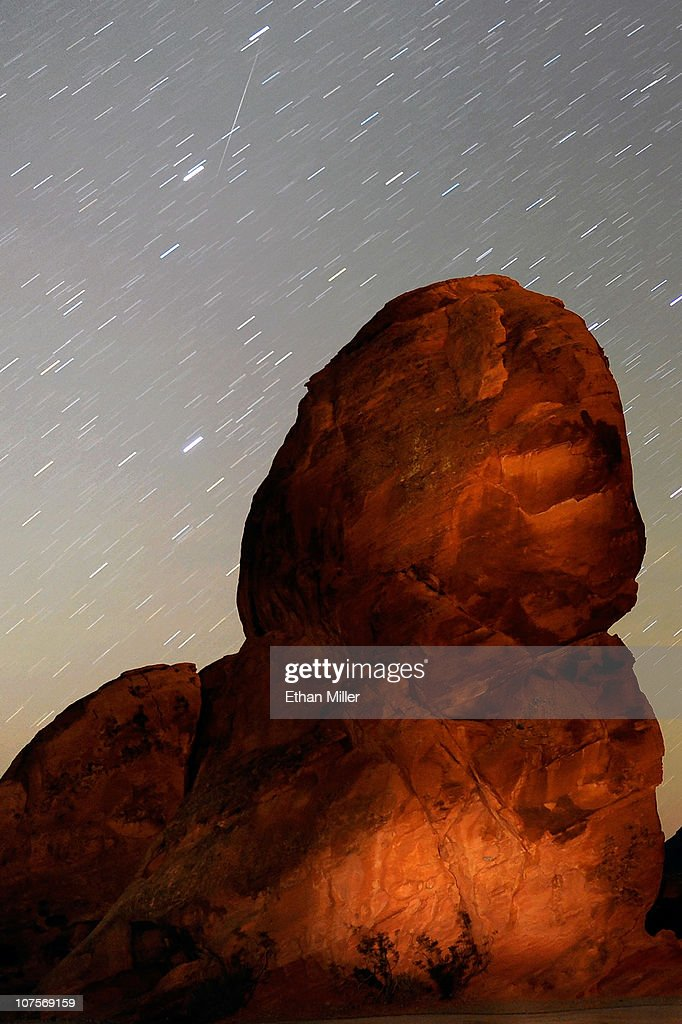Geminid meteor streaks above one of the peaks of the Seven Sisters rock formation early December 14, 2010 in the Valley of Fire State Park in Nevada. The meteor display, known as the Geminid meteor shower because it appears to radiate from the constellation Gemini, is thought to be the result of debris cast off from an asteroid-like object called 3200 Phaethon. The shower is visible every December.